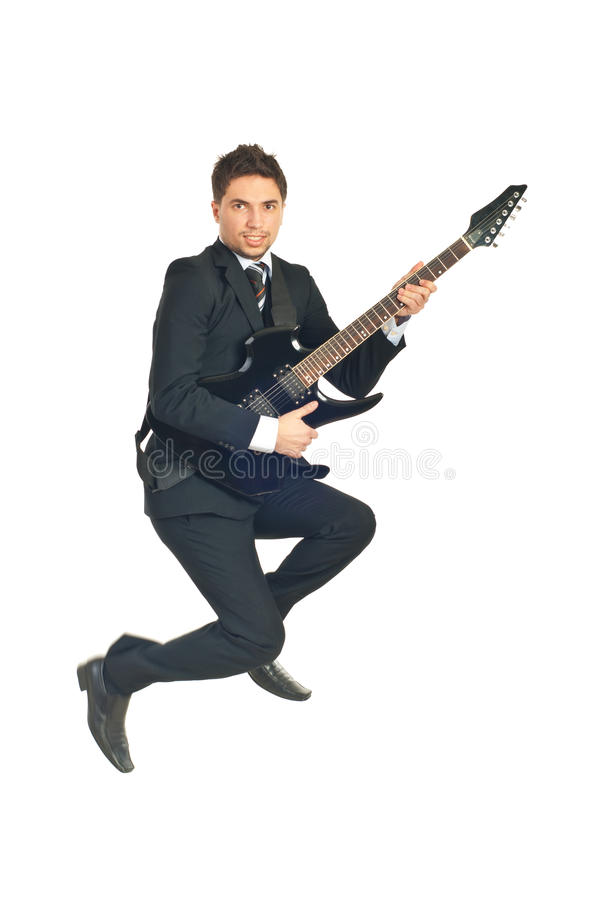 Jumping Business Man With Guitar Stock Photography