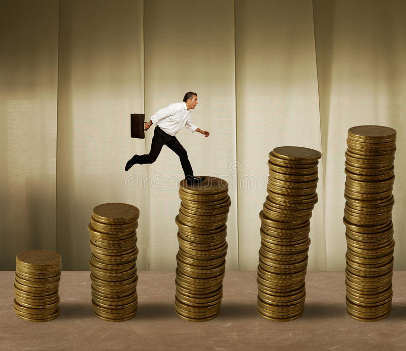 Jumping Businessman On Money Stock Photo