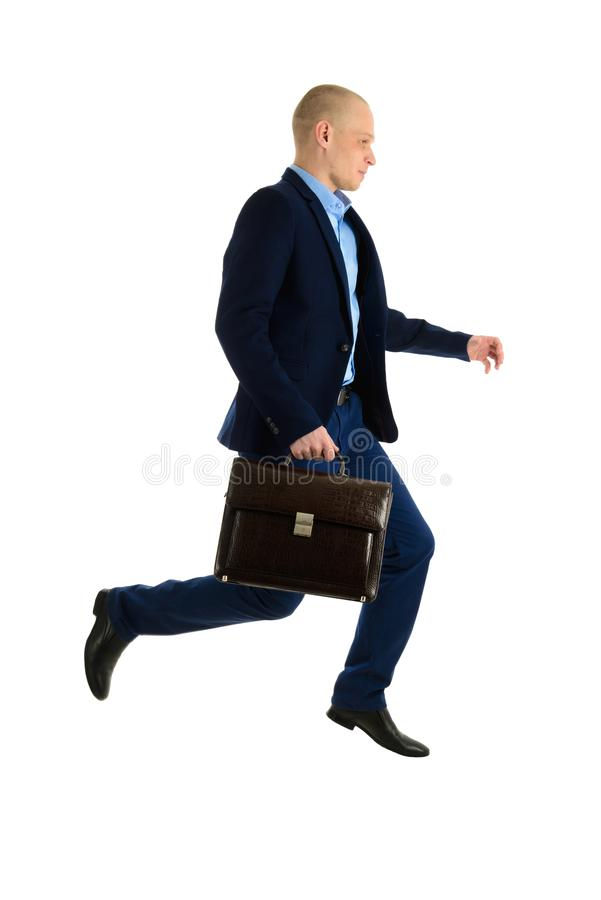 Jumping Businessman in suit with briefcase, isolated on white background, full length portrait. royalty free stock photography