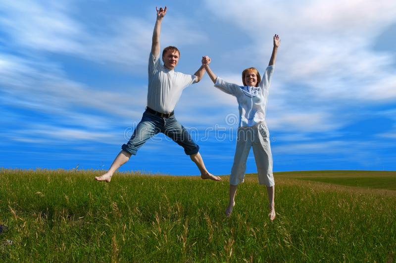 Stock Photography  Jumping Couple In Field Under Clouds Picture ... 8d6e9936efd
