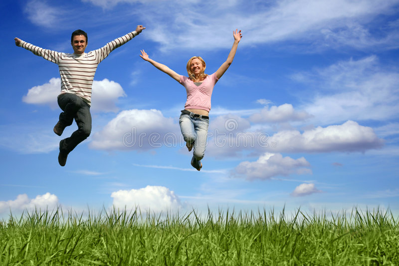 Jumping Couple Outdoor Royalty Free Stock Photography