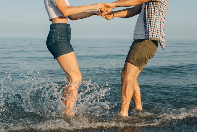 The jumping couple in water royalty free stock image