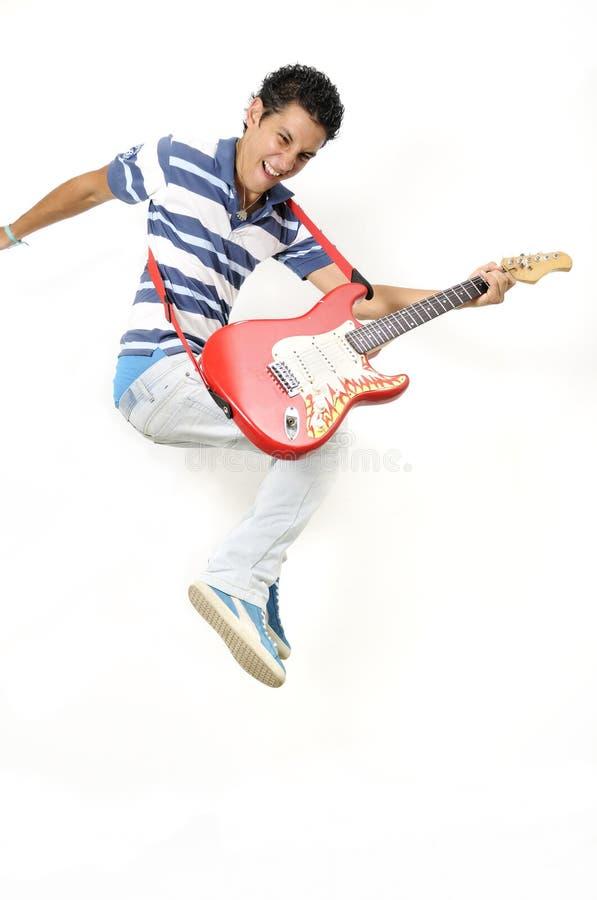 Jumping with electric guitar stock photos
