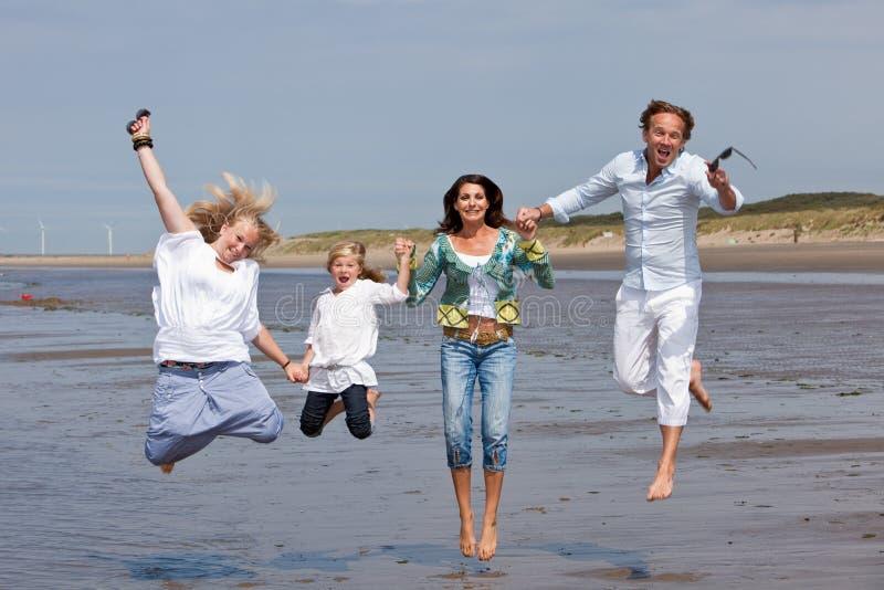Jumping family royalty free stock photo