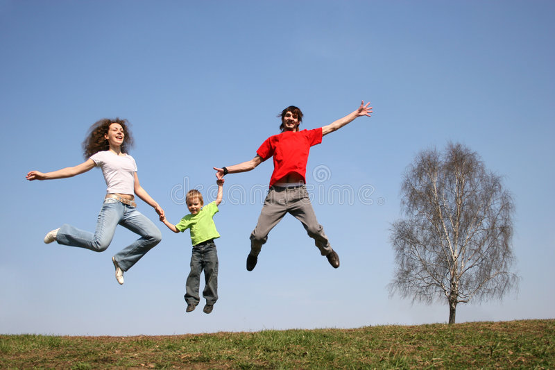 Jumping family. spring. royalty free stock photos