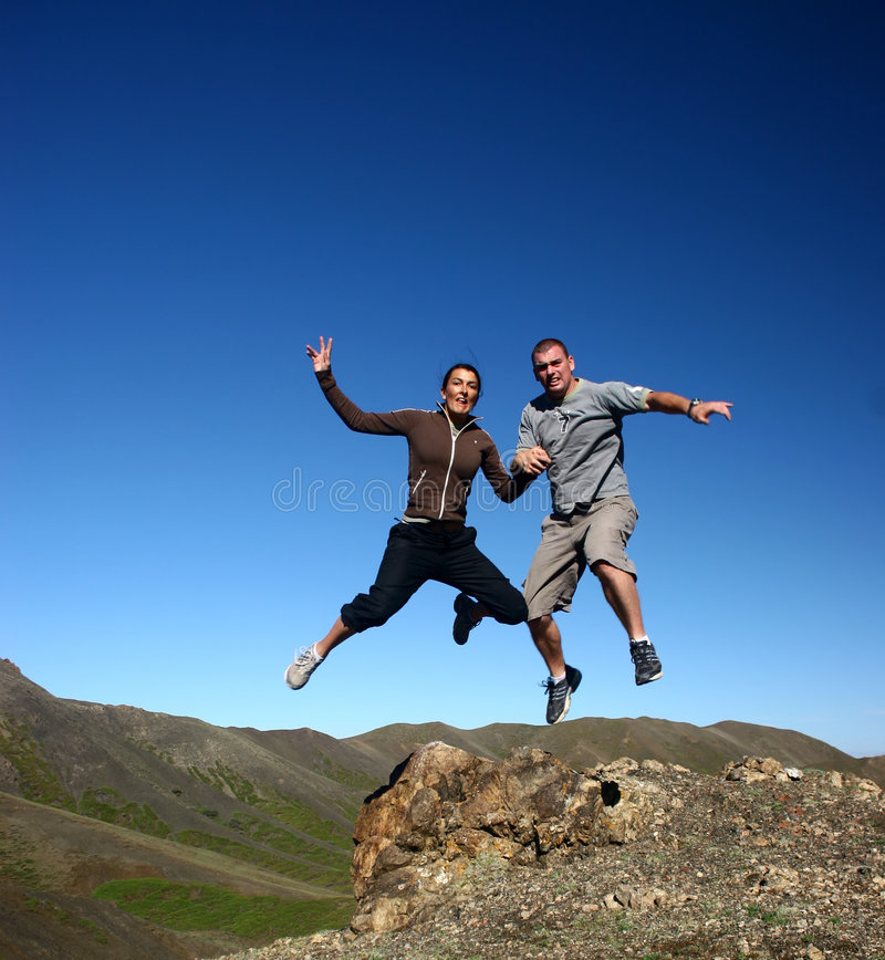 Jumping fpr joy royalty free stock photography