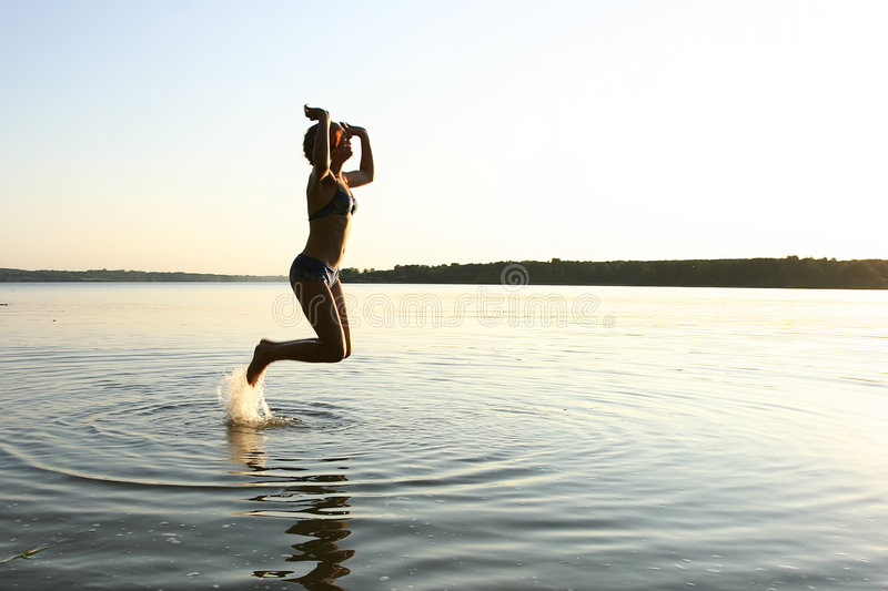 Download Jumping girl stock photo. Image of break, body, shore, movement - 147196