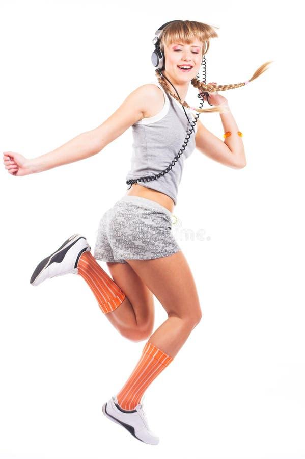 Jumping girl in headphones