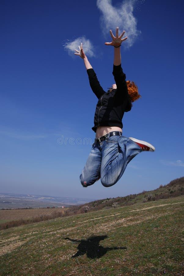 Jumping girl. No faces visible. royalty free stock photography