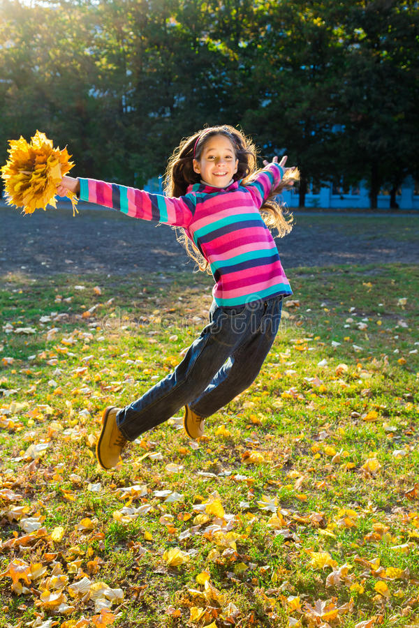 Free Jumping Girl With Autumn Leaves Stock Photo - 58139690