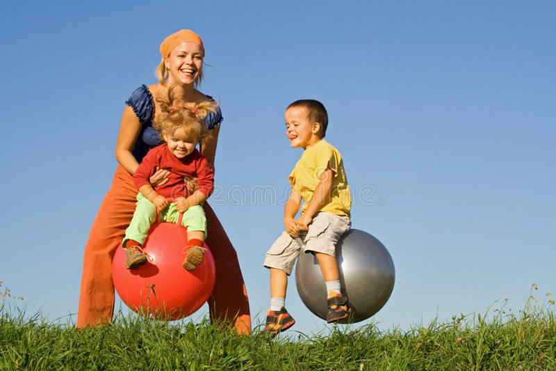 Download Jumping in the grass stock image. Image of motherhood - 3794681