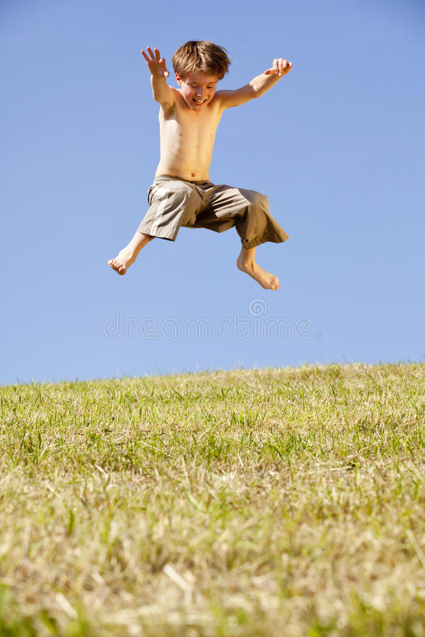 Jumping Happy Boy Stock Image