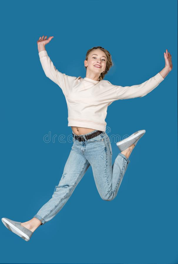 happy jumping teen girl isolated royalty free stock images