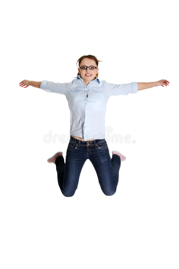 Jumping happy teen girl royalty free stock photography