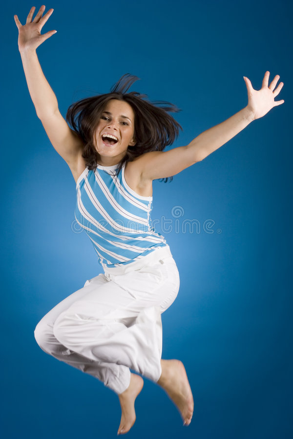 Jumping happy woman royalty free stock photography