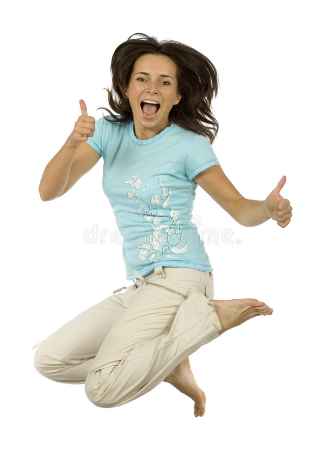 Jumping happy woman shows OK stock photography