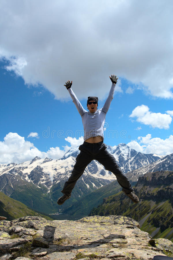 Jumping hiker stock photography