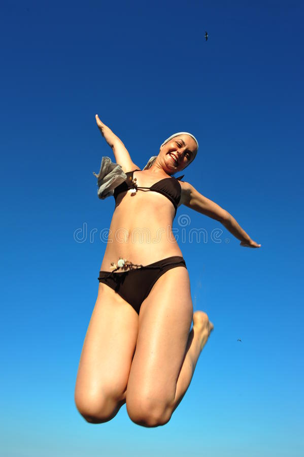 Download Jumping Jack - Woman Doing An Acrobatic Jump Stock Photo - Image: 15459368