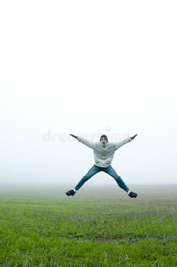 Jumping jacks in field stock photos