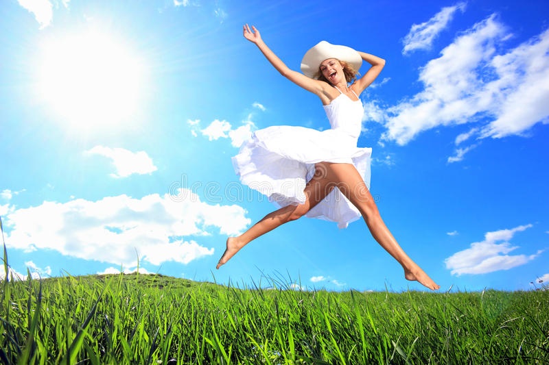 Download Jumping For Joy On A Grass Hill Stock Photo - Image: 19121220
