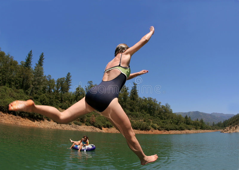 Jumping in the lake royalty free stock photos