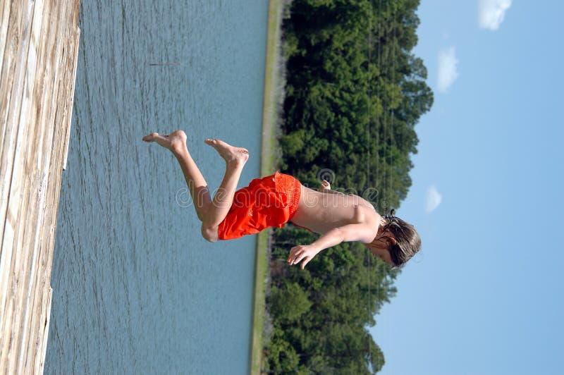 Jumping in lake stock photos