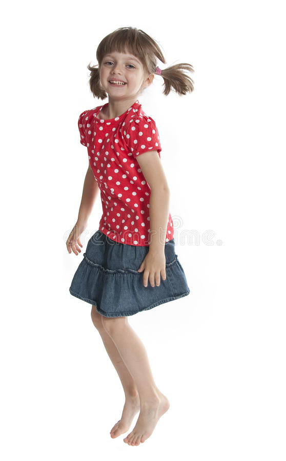 Jumping little girl stock photo