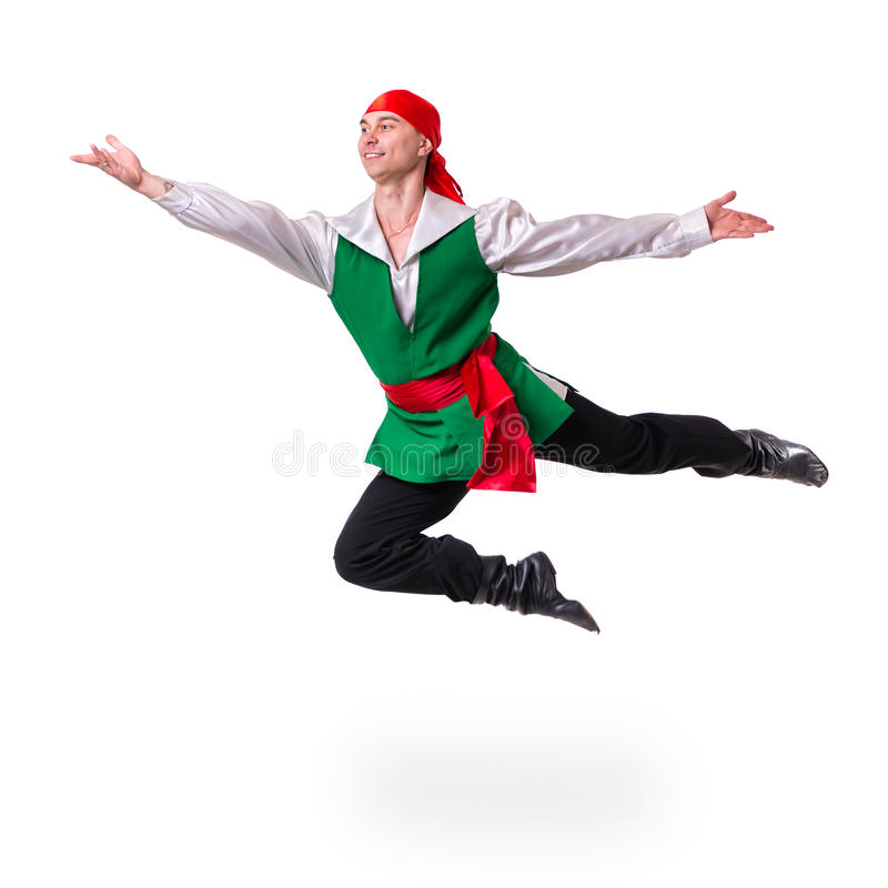 Jumping man wearing a pirate costume. Isolated on stock photography