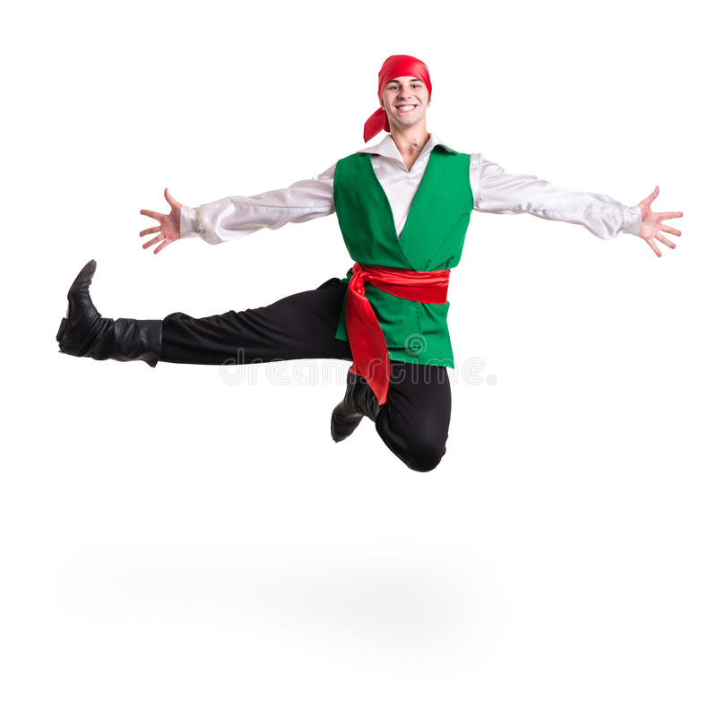 Jumping man wearing a pirate costume. Isolated on. White background in full length stock photography
