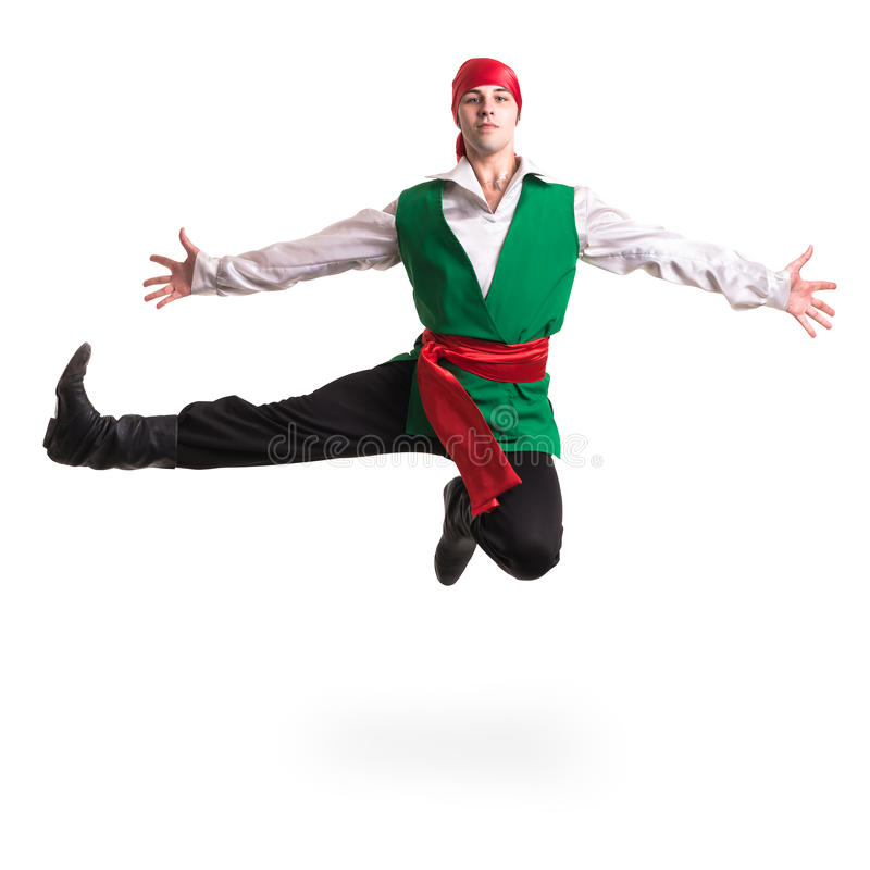 Jumping man wearing a pirate costume. Isolated on white in full length. Jumping man wearing a pirate costume. Isolated on white background in full length royalty free stock image