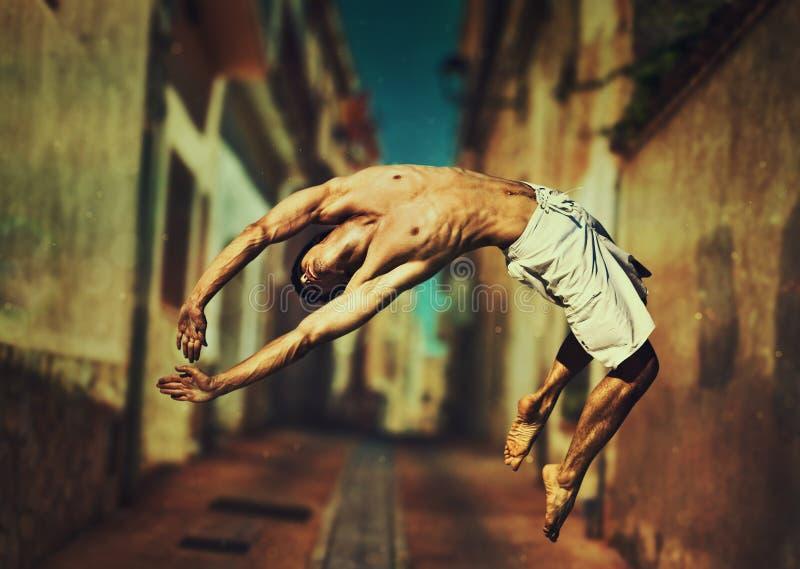 jumping man young fotografering för bildbyråer