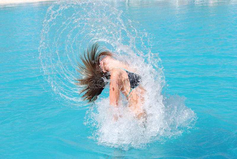 Jumping out of pool stock photos