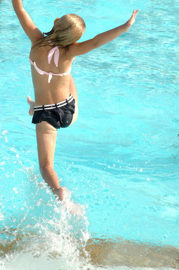 Jumping in Pool stock photography