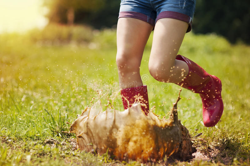 Download Jumping in puddle stock image. Image of messy, feet, vitality - 31805479