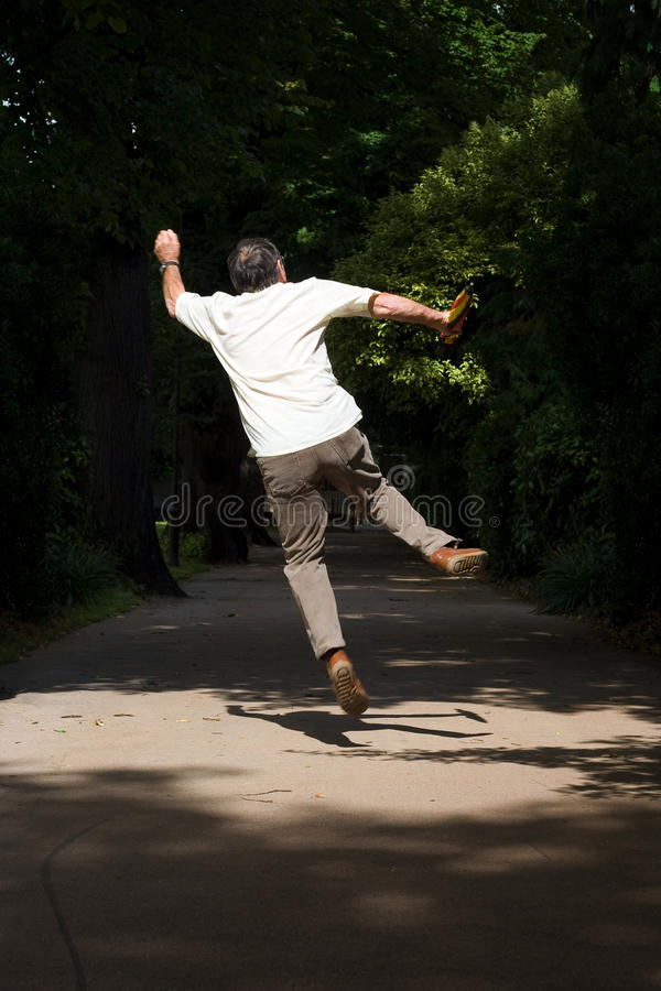 Jumping Retired Man Royalty Free Stock Photography