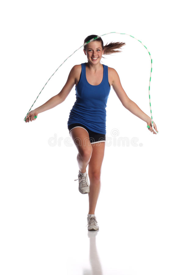 Jumping rope. Teen jumping rope on white background stock photography
