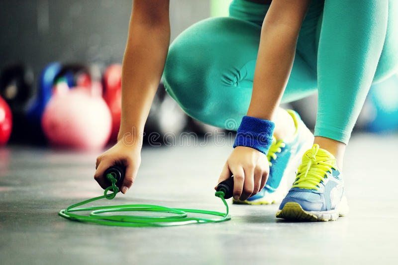 Jumping rope close up. Young fit woman is taking jumping rope. Close up royalty free stock images