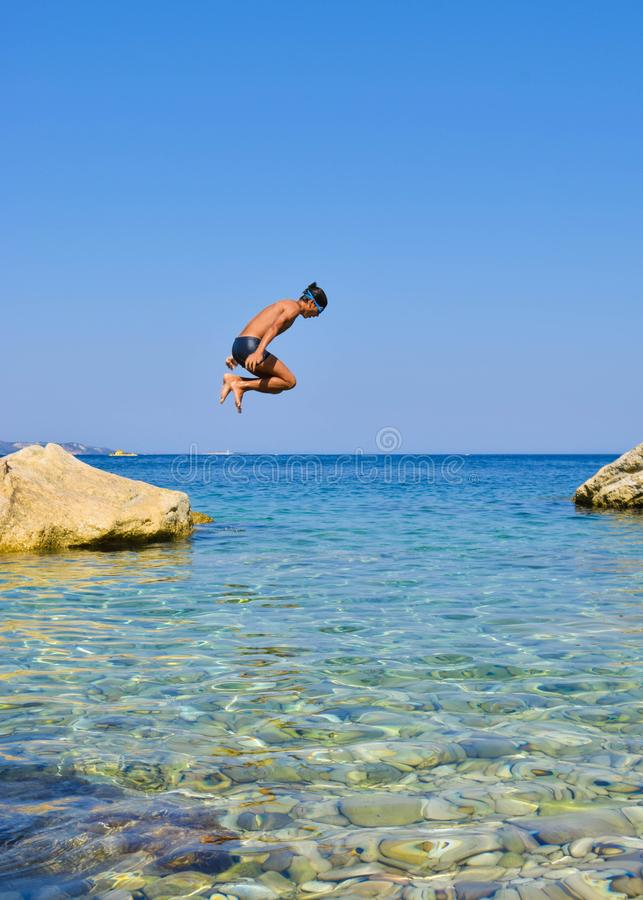 Jump into the sea. royalty free stock images