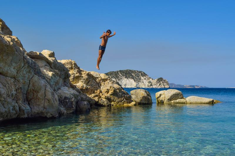 Jump into the sea. royalty free stock photo