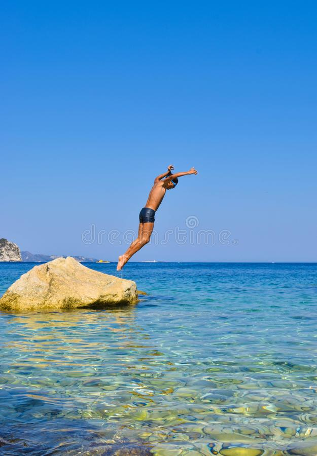 Jump into the sea. royalty free stock photos