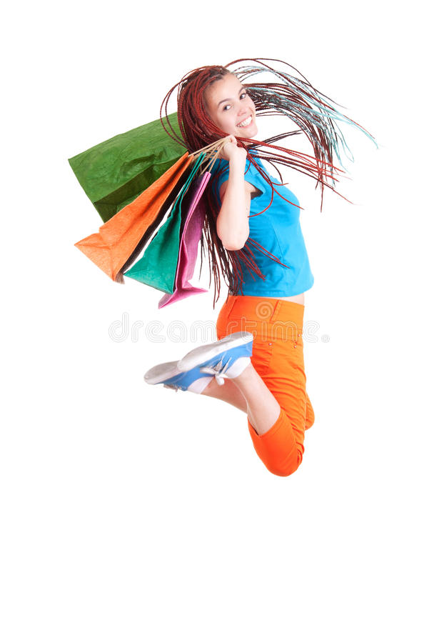 Jumping Shopping Girl In Ethnic Hairdo With Bags Royalty Free Stock Images