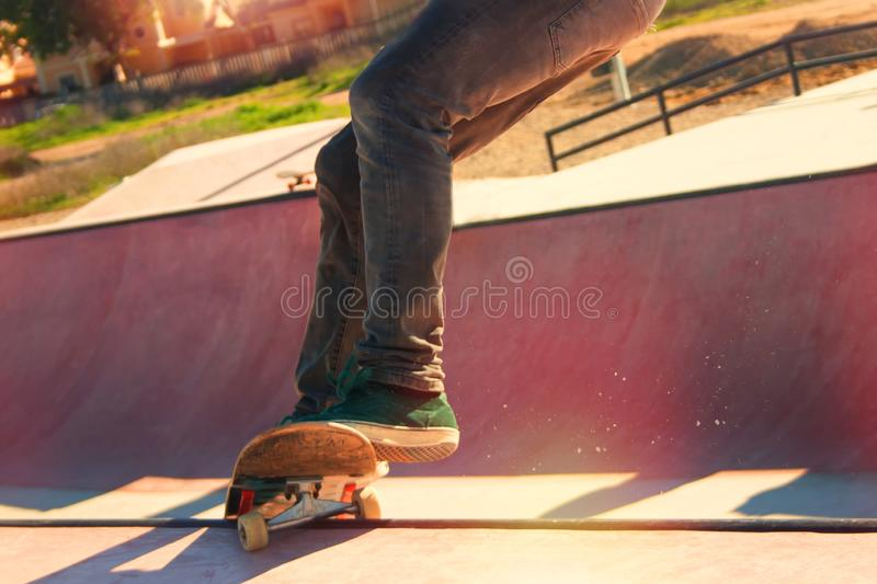 Jumping on a skateboard. Teenage skateboarder boldly makes extreme jumps on a skateboard royalty free stock photography