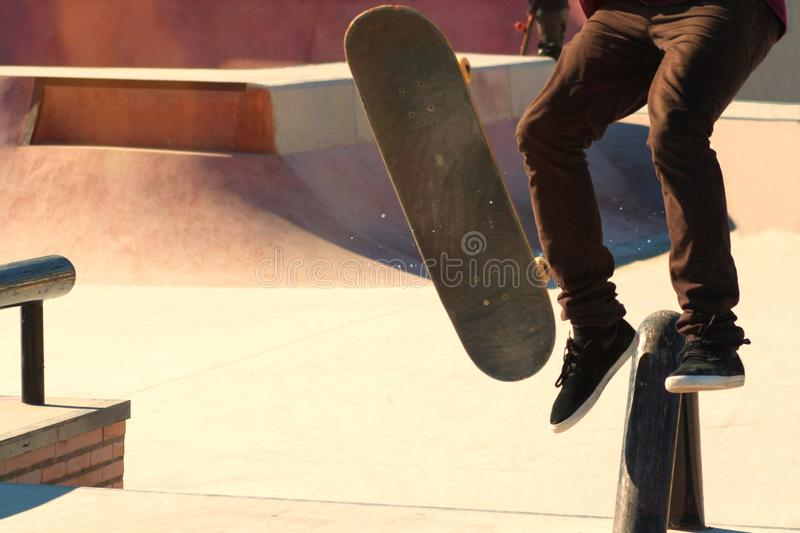 Jumping on a skateboard. Teenage skateboarder boldly makes extreme jumps on a skateboard royalty free stock photo