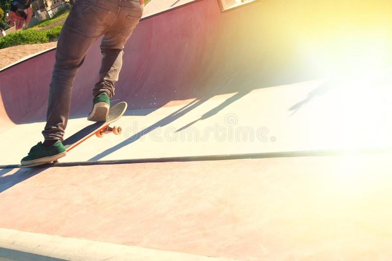 Jumping on a skateboard. Teenage skateboarder boldly makes extreme jumps on a skateboard stock photo