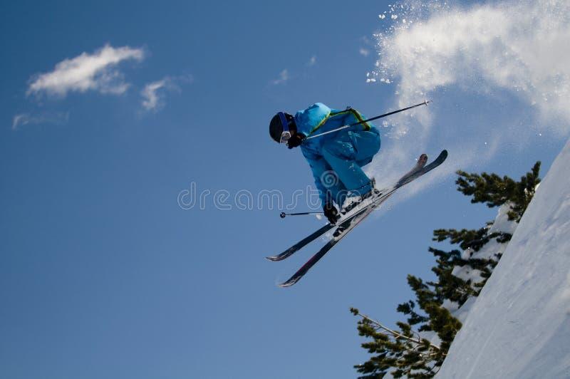 Jumping skier stock photo
