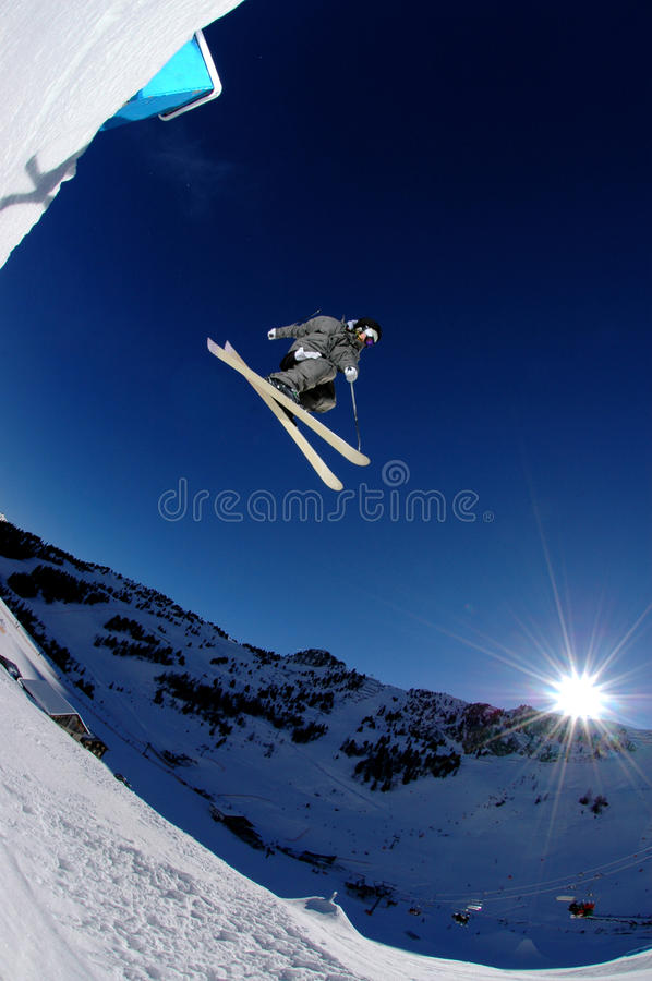 Free Jumping Skier In The Sun On Blue Sky Stock Image - 16204711