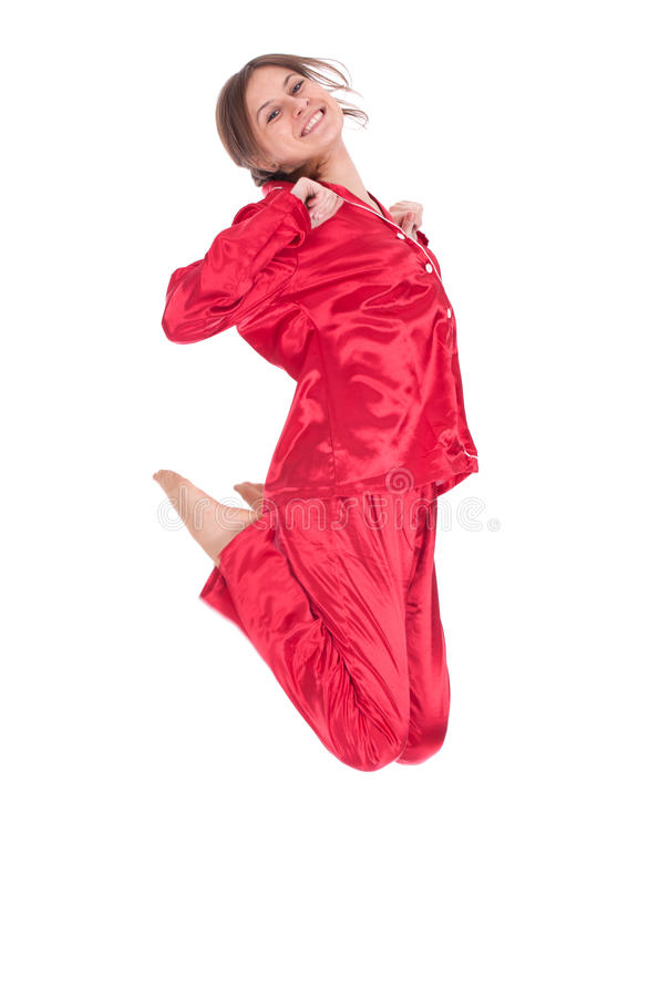 Download Jumping Smiling Young Woman In Red Pajamas Stock Photo - Image of joyful, camera: 19266454