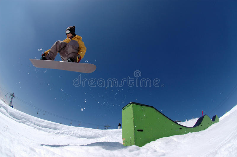 Download Jumping snowboarder stock image. Image of orange, action - 16204549