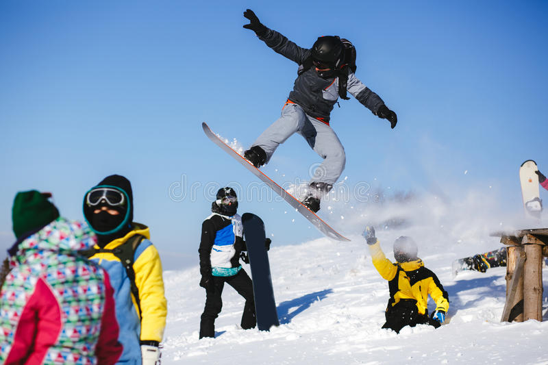 Download Jumping Snowboarder On Blue Sky Background Editorial Stock Photo - Image: 83705603