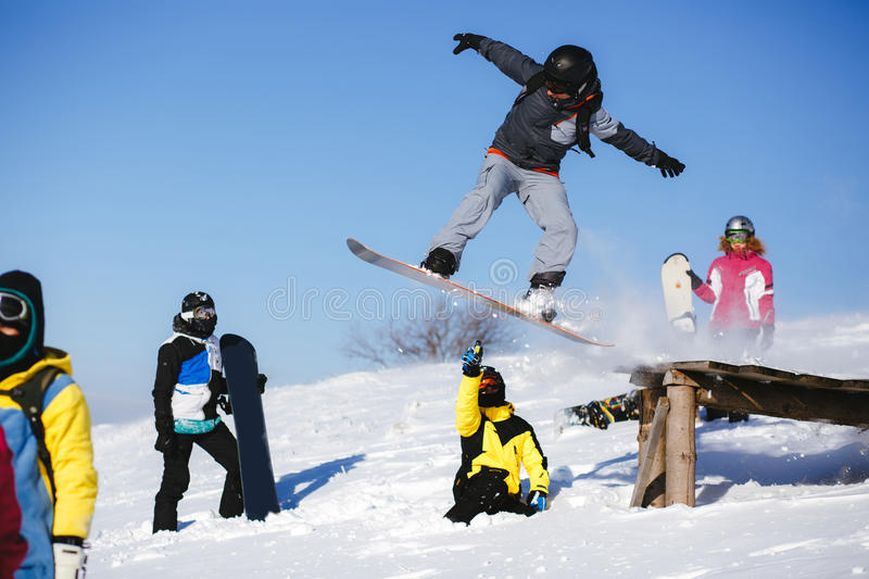 Download Jumping Snowboarder On Blue Sky Background Editorial Stock Photo - Image: 83705648